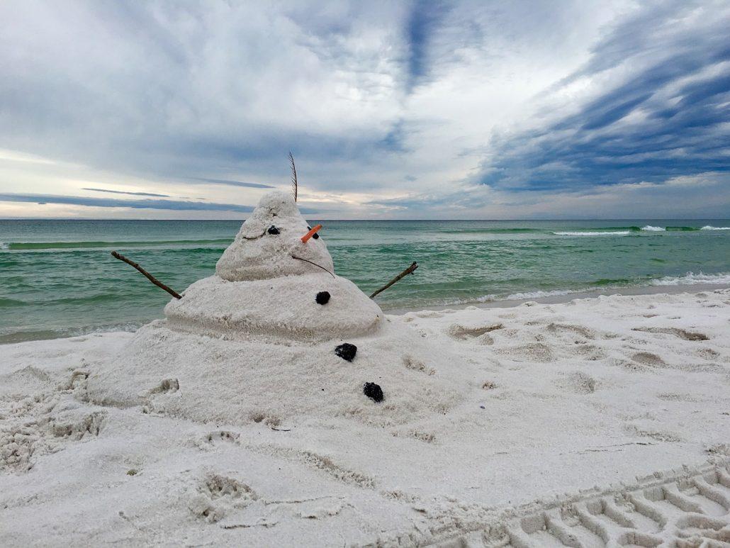 sand snowman celebrates Christmas in Costa Rica