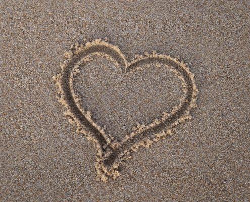 Tamarindo destination wedding heart in sand-min